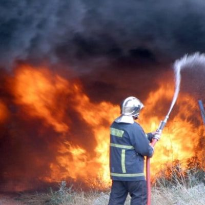 Brush fires threaten homes in Greece