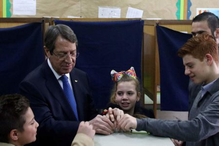 Greek Cypriots vote in runoff, in hopes of peace deal