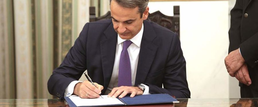 Mitsotakis takes over as Greece's PM with radical change of style
