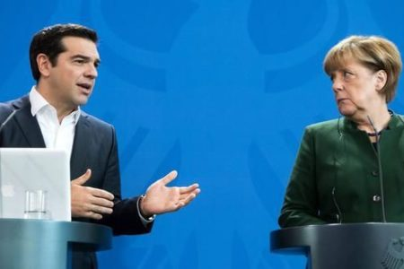 Tsipras talks with Merkel, stresses need to complete 2nd review