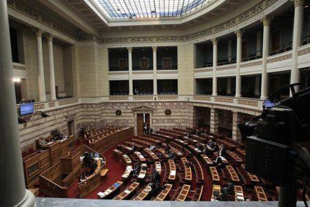 Greek lawmakers debate extending austerity to decade mark