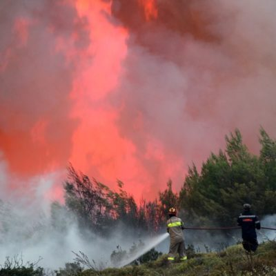 Firefighters battle wildfires across Greece
