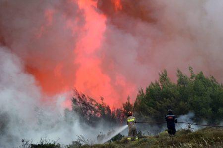 Firefighters battle wildfires across Greece