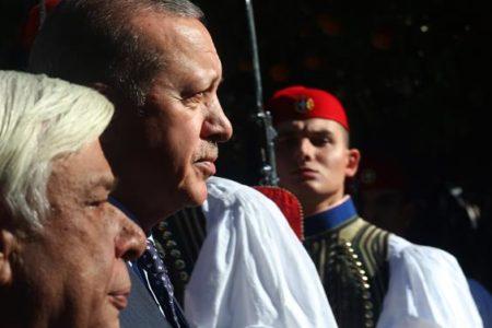 Erdogan visits Greece, says border treaty needs changes